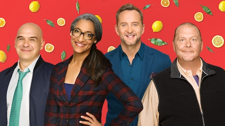 Michael Symon, Mario Batali, Carla Hall and Clinton Kelly stand together