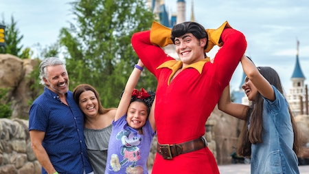 Gaston poses for a family