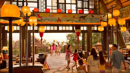Guests walking through the lobby at Aulani Resort