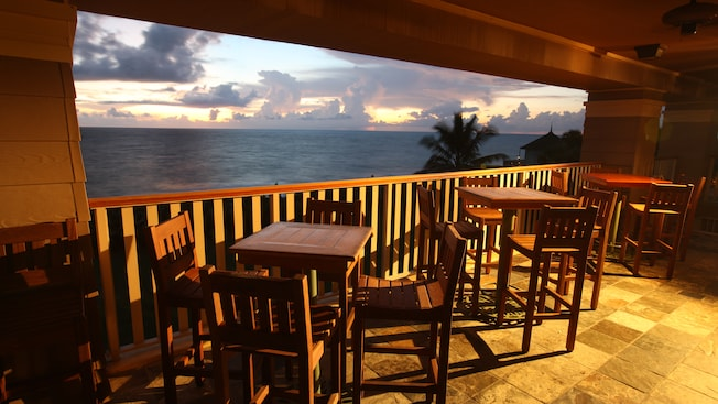 High Tables And Chairs On The Patio Overlook The Ocean Below. Vero Beach  Resort Area