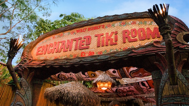 Overhead sign for and entrance to Walt Disney's Enchanted Tiki Room in Adventureland