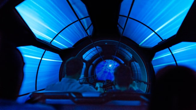 Guests enter a dark, mysterious tunnel while riding Hyperspace Mountain