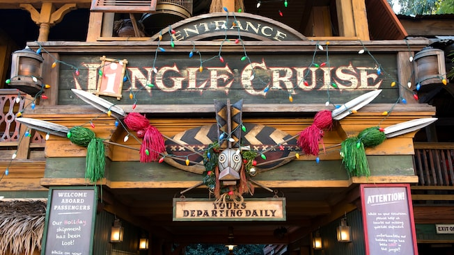 The entrance sign, where Jungle Cruise has been changed to read Jingle Cruise