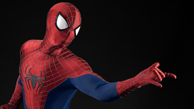 A Spider Man Disney Character holding his arm out in a web slinging pose