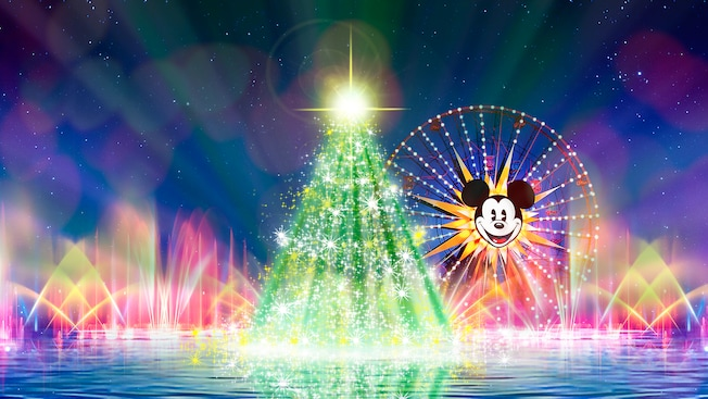 Illuminated fountains, a Christmas tree with a star on top and Mickey's Fun Wheel during the World of Color Season of Light spectacular