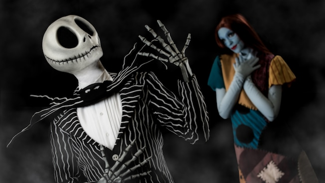 Jack Skellington strikes a dramatic pose as Sally looks on lovingly