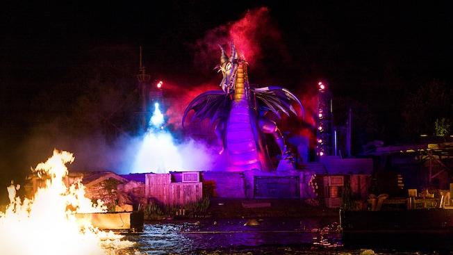 The impressive evil dragon rises from smoke during the Fantasmic! finale