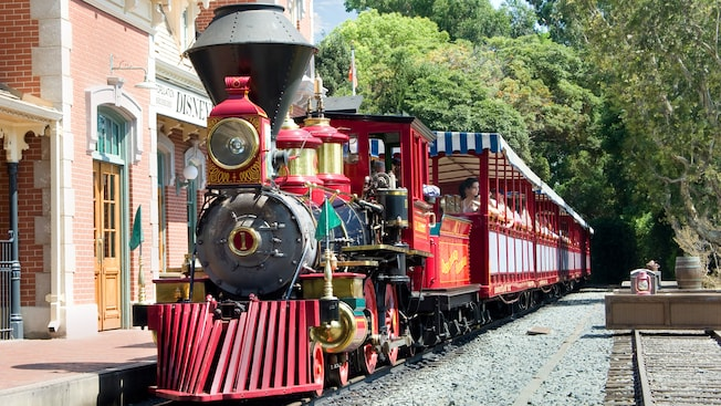 The Disneyland Railroad is stopped at the Main Street, U.S.A. station near the parks main entrance
