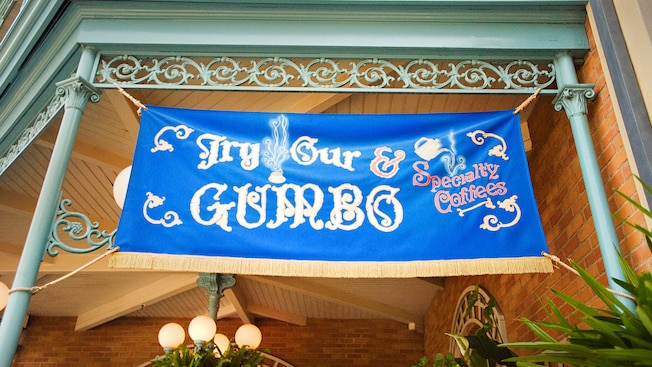 Try Our Specialty Coffees & Gumbo sign for Royal Street Veranda, a Disneyland restaurant.
