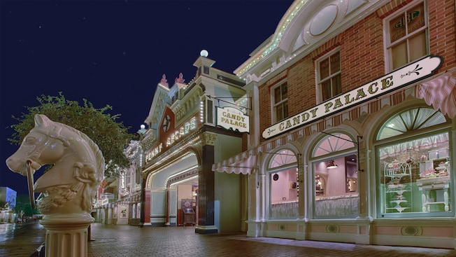 The Candy Palace and Penny Arcade lighting up the night down Main Street, U.S.A. at Disneyland Park