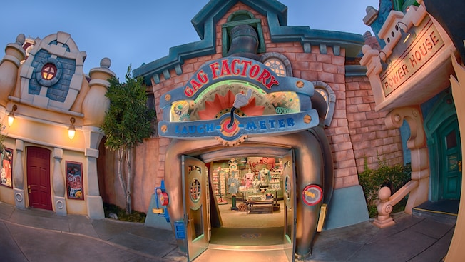 A whimsical laugh-o-meter featuring a Mickey glove pointing toward Gag Factory Toontown Five & Dime
