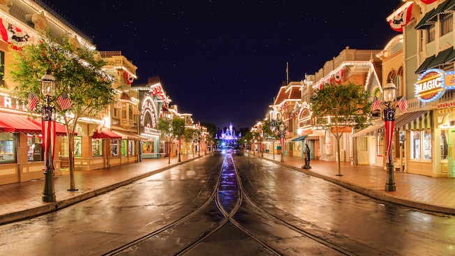 Vibrant lights line rooftops and marques at Main Street, U.S.A. on the way to Sleeping Beauty Castle