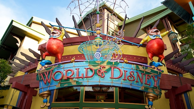 Fanciful entrance sign for World of Disney features Tweedle Dee and Tweedle Dum