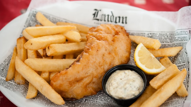 Fish and chips with tartar sauce on a newspaper