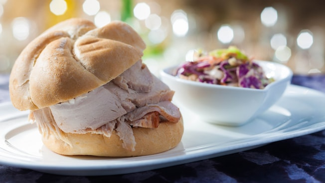 Hand-carved turkey sandwich on a Kaiser roll with side of red cabbage slaw
