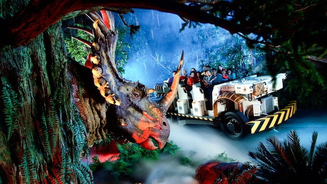 Profile Of A Triceratops As Time Rover Filled With Guests Drives By At The Dinosaur Disneys Animal Kingdom Theme Park