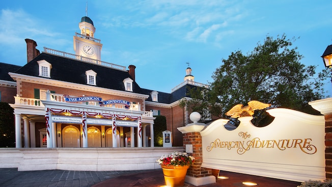 The sign and main entrance to The American Adventure, housed in a colonial-style brick building