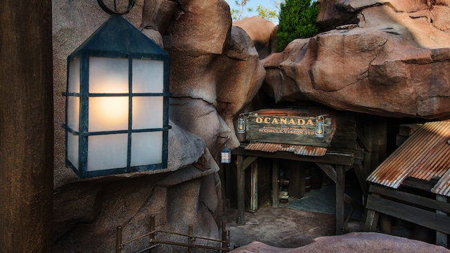 Entrance to 'O Canada!' attraction tucked under boulders in the Canada Pavilion at Epcot