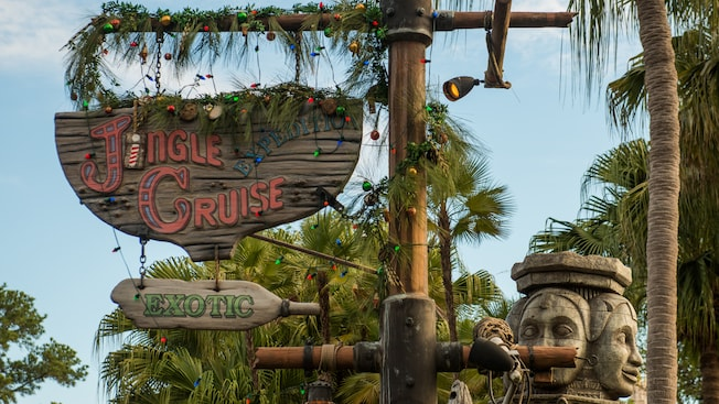 The 'Jungle Cruise' sign at Magic Kingdom park, decorated for Christmas and renamed 'Jingle Cruise'