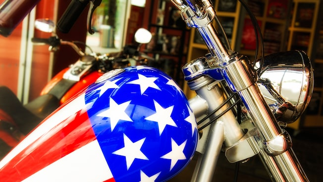 Stars and stripes from the American flag decorate the gas tank of a Harley Davidson motorcycle