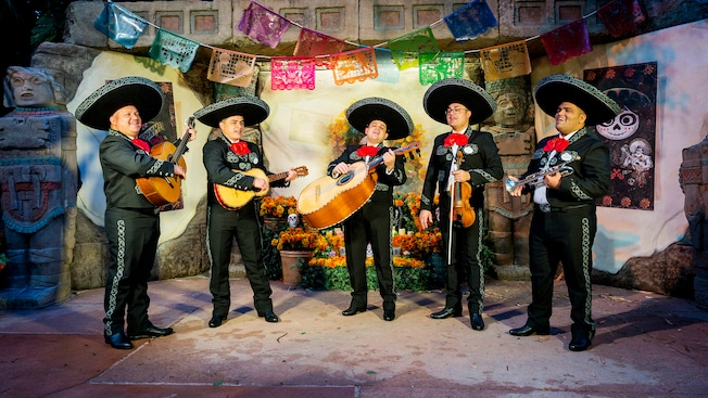 Band members from El Mariachi Coco de Santa Cecilia perform outdoors at the Mexico Pavilion at Epcot