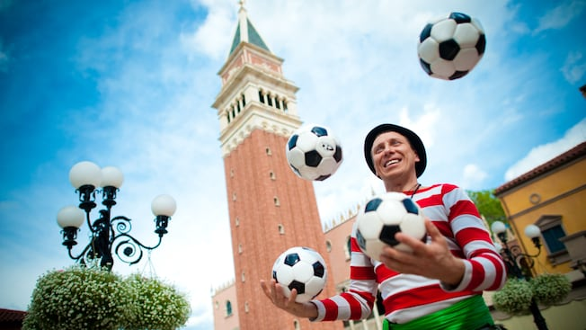 Master juggler and comedy mime Sergio juggles 4 soccer balls at the Italy Pavilion in Epcot