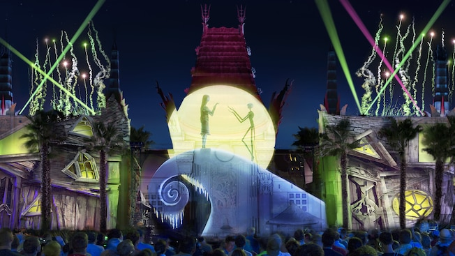 A crowd watches a light show featuring characters from the Disney film Nightmare Before Christmas projected on to the exterior of the Chinese Theater at Disney's Hollywood Studios