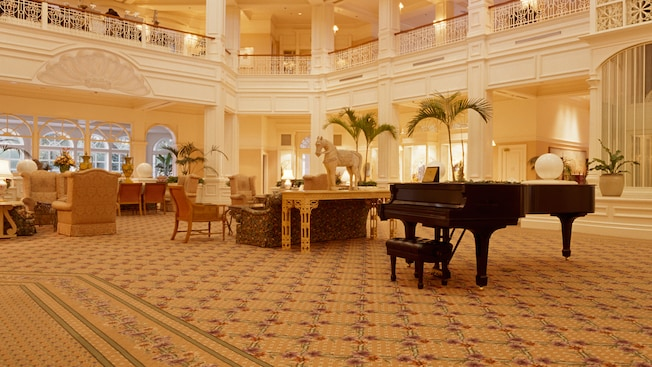 A grand piano sits in the center of the elegant hotel lobby at Disney's Grand Floridian Resort & Spa
