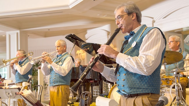 Members of Disney's Grand Floridian Lobby Society Orchestra play their instruments