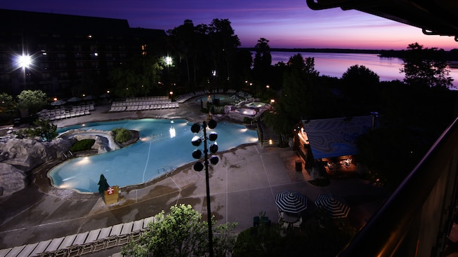 Wide view of the Hidden Springs Pool at Disney's Wilderness Lodge in the early evening
