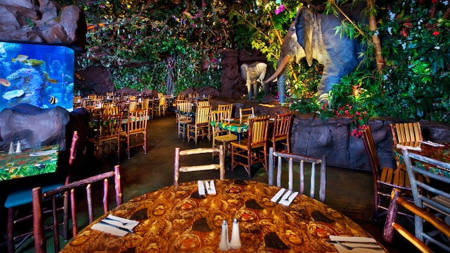 "A placa do Rainforest Cafe diz: ""A wild place to shop and eat"""
