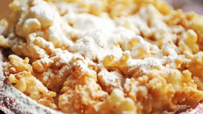 Crispy funnel cake sprinkled with powdered sugar