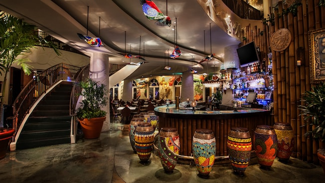 Colorful bar area with bongo drum-shaped bar stools