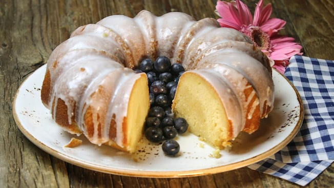 A plated vanilla bundt cake with grapes
