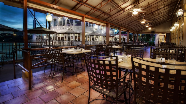 Covered patio of Portobello Country Italia Trattoria at Downtown Disney overlooking Village Lake