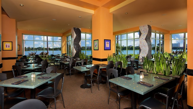 The dining room of Wolfgang Puck Grand Cafe with a lake view in the distance