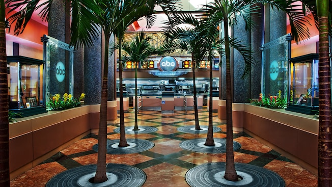 Two rows of palm trees adorn the interior entryway to ABC Commissary at Disney's Hollywood Studios