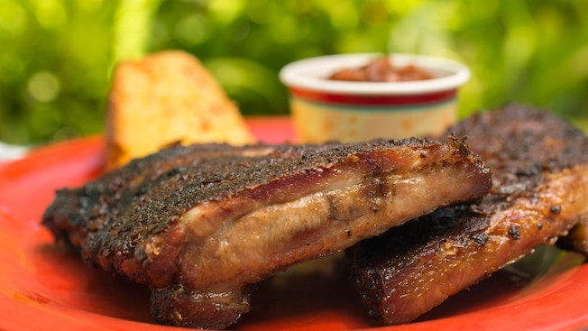 Juicy barbecue ribs are served with a side of baked beans at Fairfax Fare in Disney's Hollywood Studios