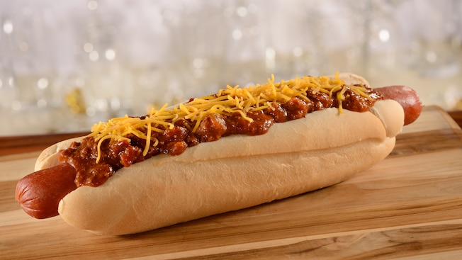 A foot long chili cheese hotdog on a bun