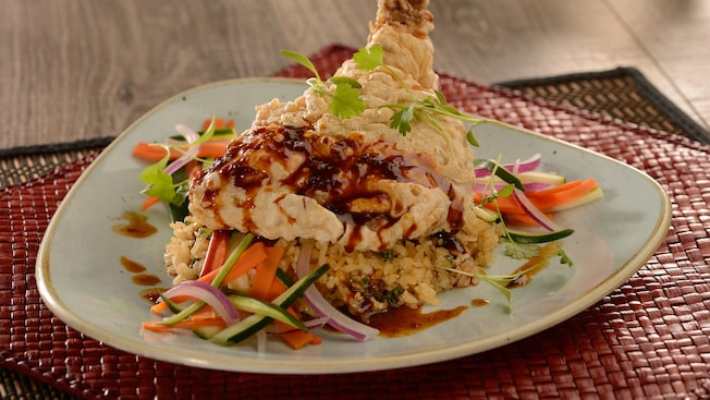 Crispy fried chicken served with citrus and ginger-scented rice, chili glaze and seasonal vegetables