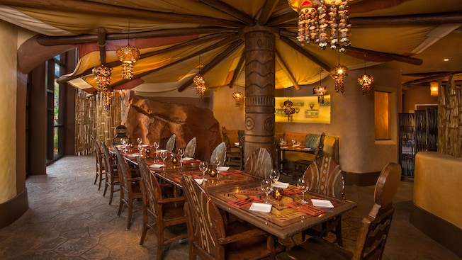 Mushroom-like canopy over a row of tables in brown tribal-themed dining room
