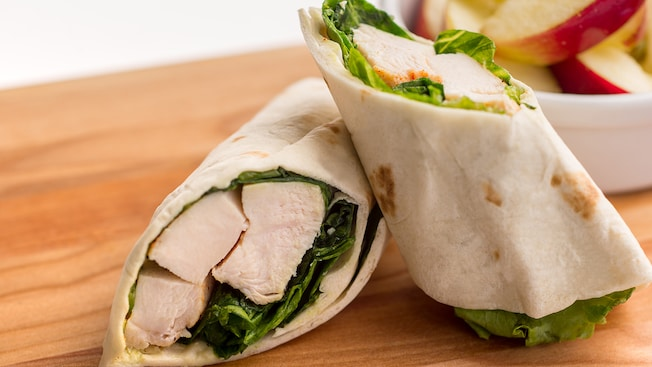 A chicken Caesar wrap filled with romaine lettuce and slices of roasted chicken