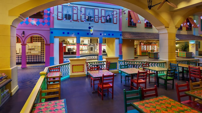 Old Port Royale Food Court Brightly Lit Dining Room With Pastel Walls And Colorful Tables Chairs