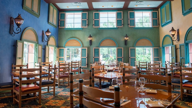Caribbean Beach Resort Shutters At Old Port Royale Open Lanterns And Large Windows Illuminating A Dining Room Filled With Chairs Tables