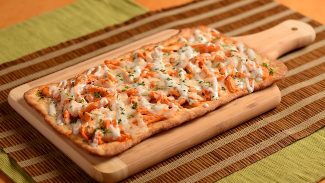 Flatbread covered in barbecue chicken, cheese and herbs