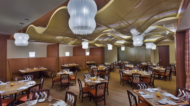 Inspired by water, this restaurant features wavy patterns on the chair backs and ceiling light fixtures