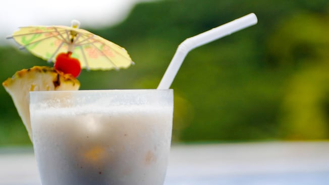 Close-up of a pina colada with umbrella