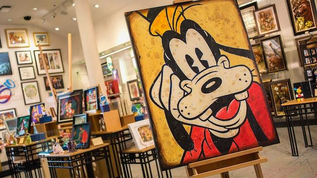 Un cuadro de Goofy exhibido sobre un caballete