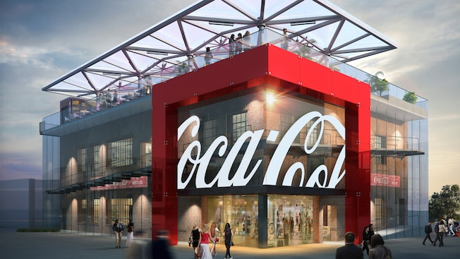 An artist's rendering of the Coca Cola store at Disney Springs, a 2-story brick building surrounded by a screened curtain wall, with a covered patio on the roof and a corner entrance framed by prominent paneled structure that features the classic Coca Cola signature logo