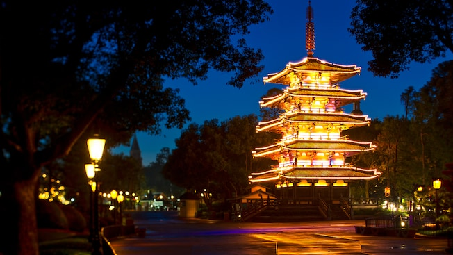 An illuminated pagoda lights a walkway at the Japan Pavilion during an enchanting evening at Epcot